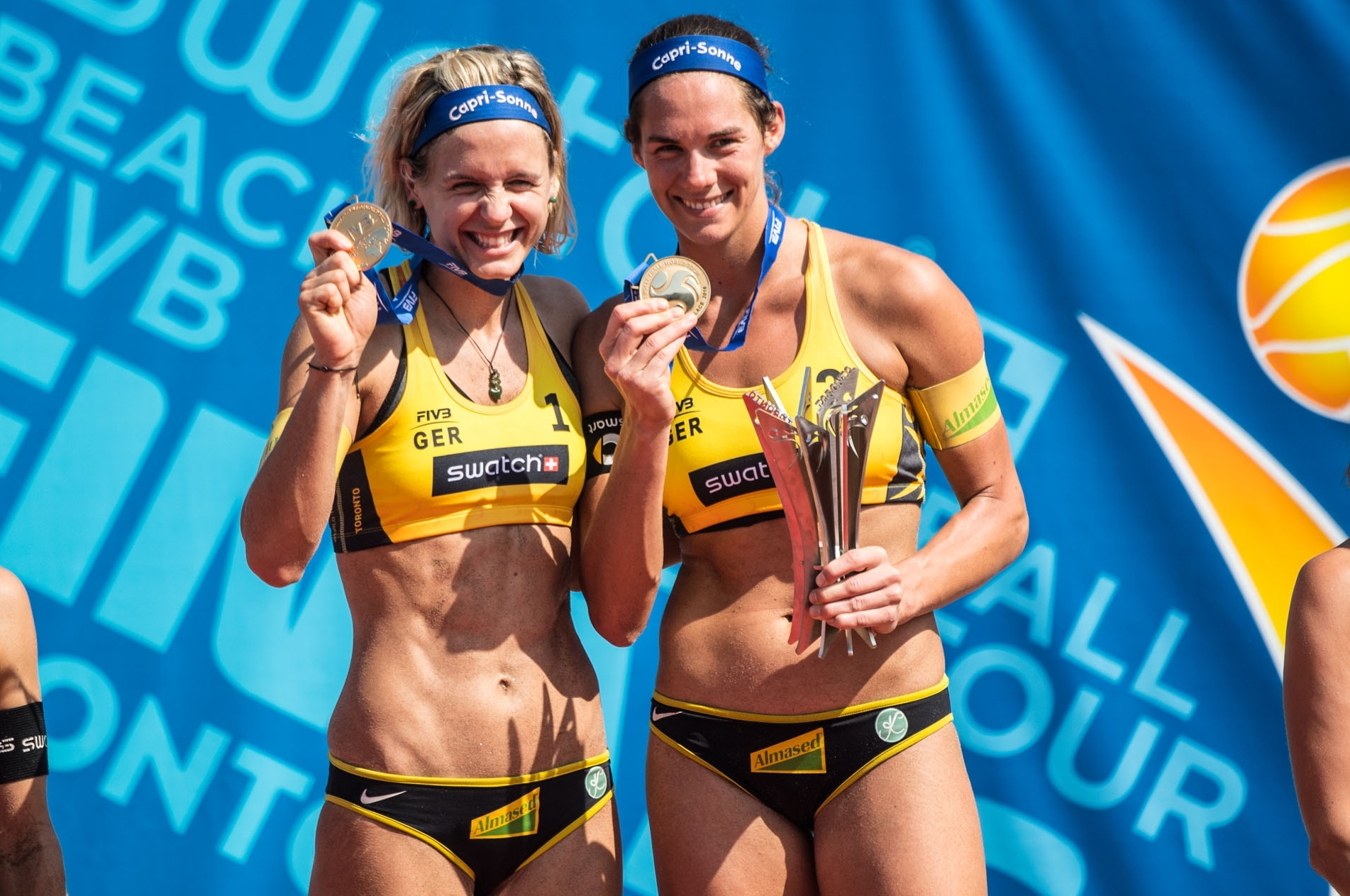 Germany's golden girls Laura Ludwig (left) and Kira Walkenhorst. Photocredit: Joerg Mitter.