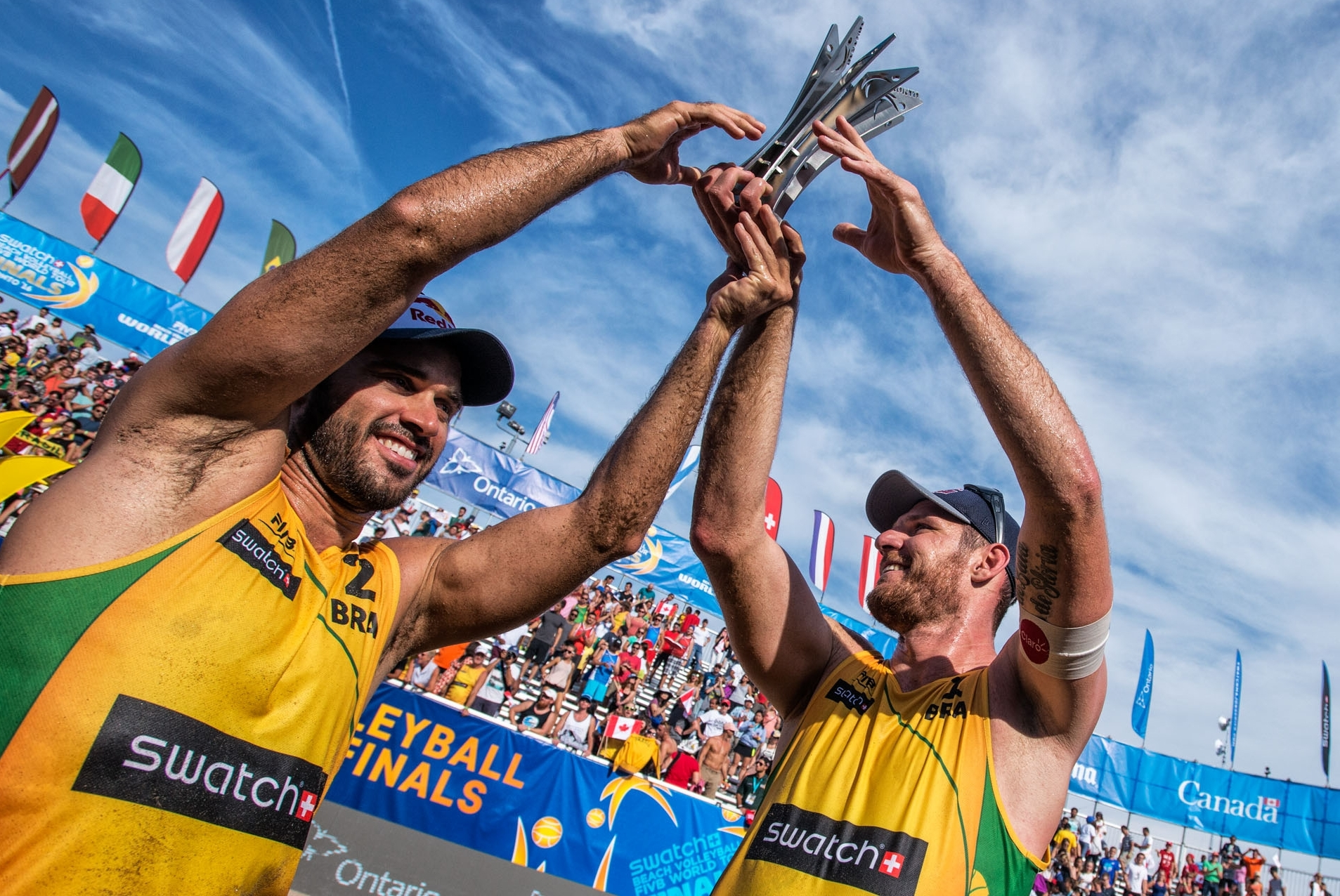 Bruno Oscar Schmidt (left) and Alison Cerutti won a second successive Swatch World Tour Finals title. Photocredit: Mihai Stetcu.